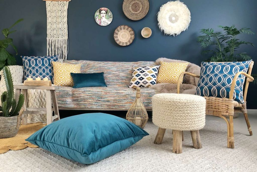 Boho Chic styled living room with blue velvet and yellow cushions