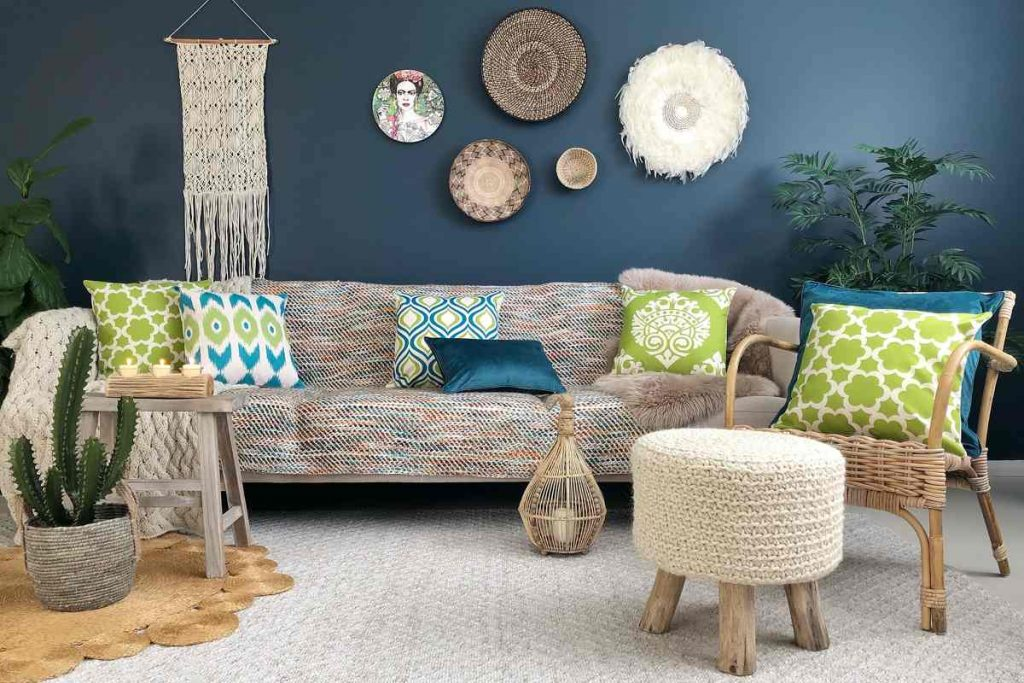 Boho chic styled room with teal and green cushions