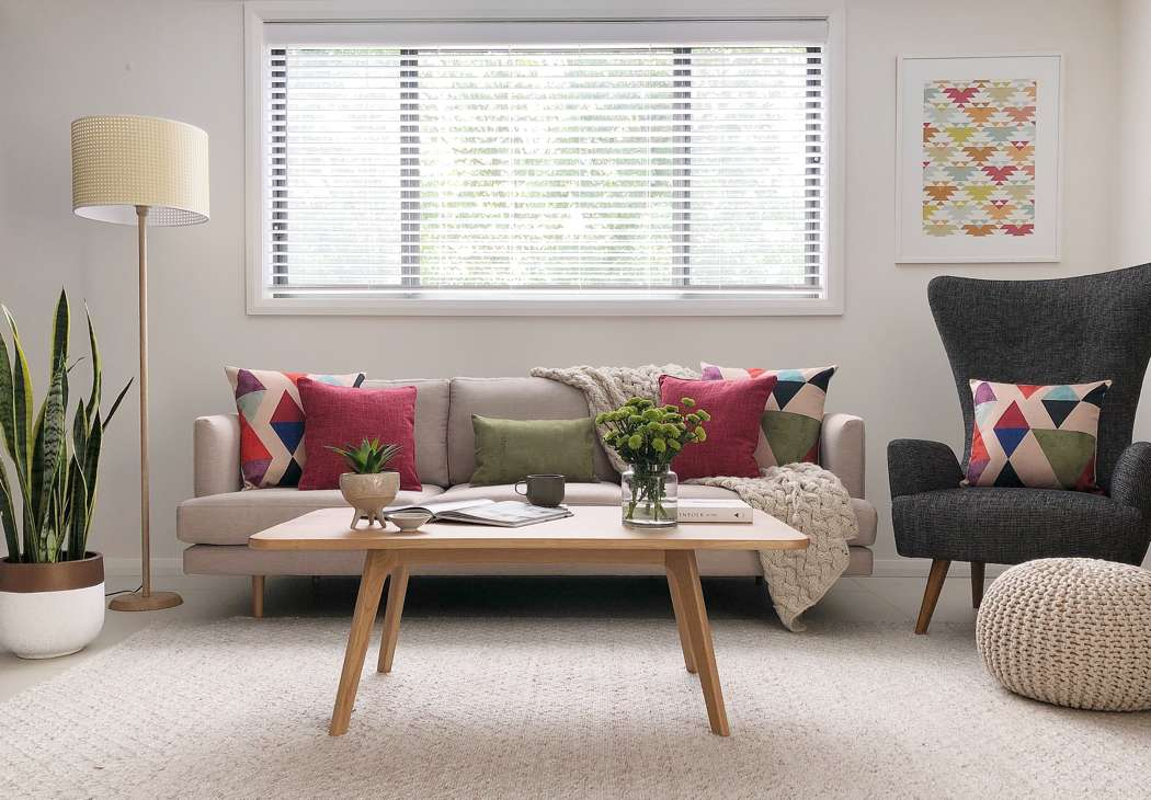 Mid century modern styled scene with red and green cushions