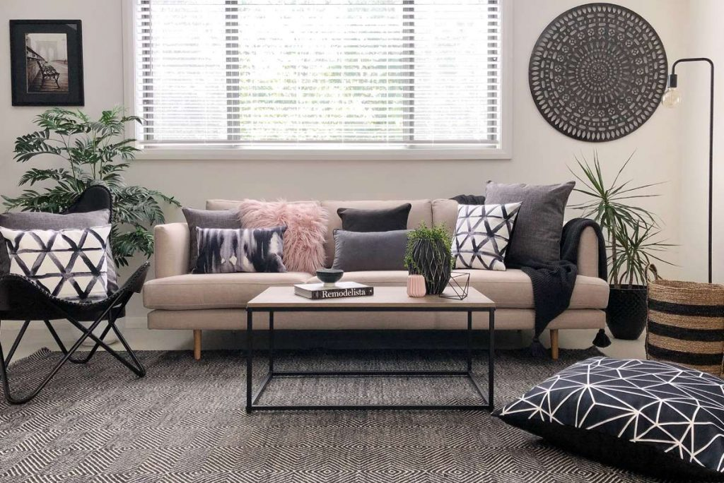 Living room with Urban modern styling with pink and grey cushions