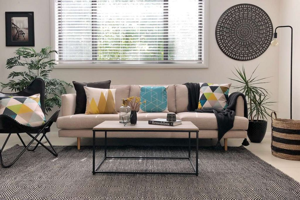 Urban modern styled living room with funky cushion and a large grey floor cushion