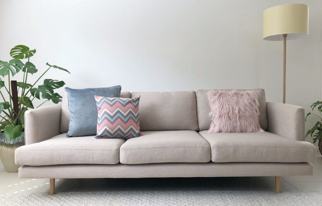 Neutral sofa with cushions in soft blues and pinks