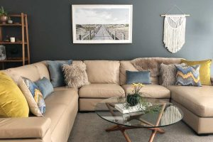 Corner lounge with blue and olive velvet cushions