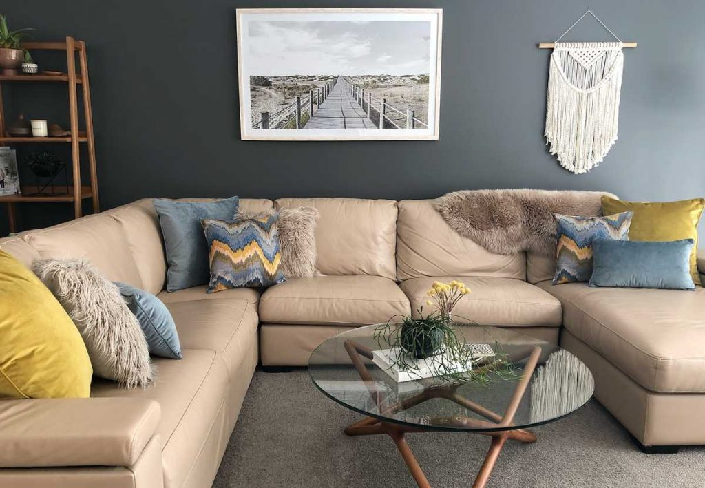 Corner sofa with mustard and light blue cushions