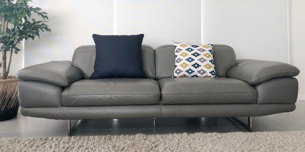 Grey sofa with navy cushion and a patterned cushion