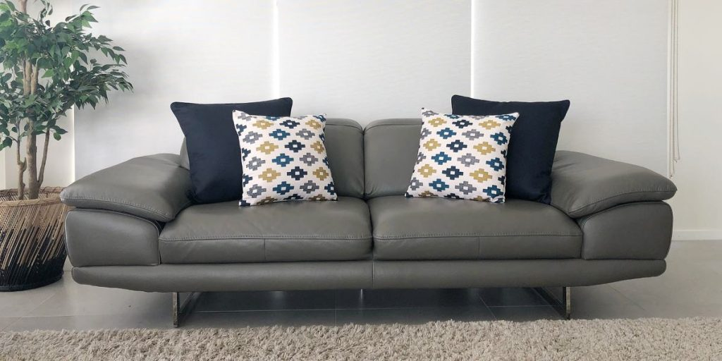 Grey sofa with a 2-2 cushion arrangement in navy and print