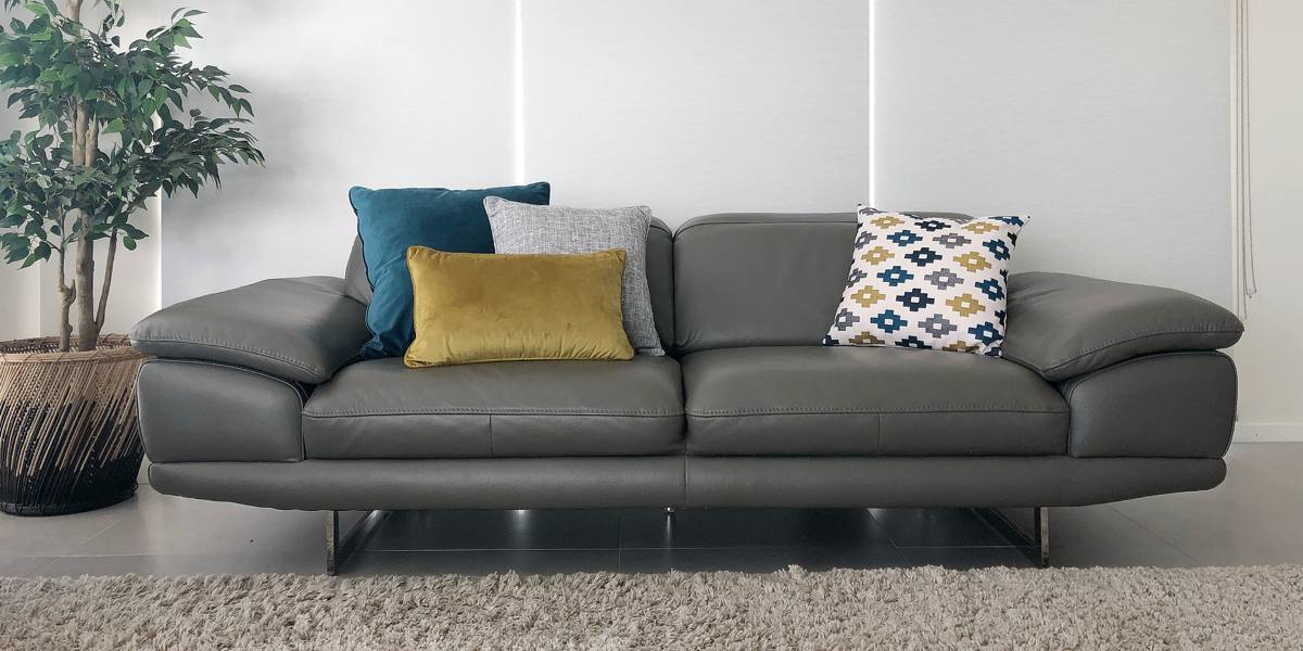 Grey Sofa With Yellow And Blue Cushions
