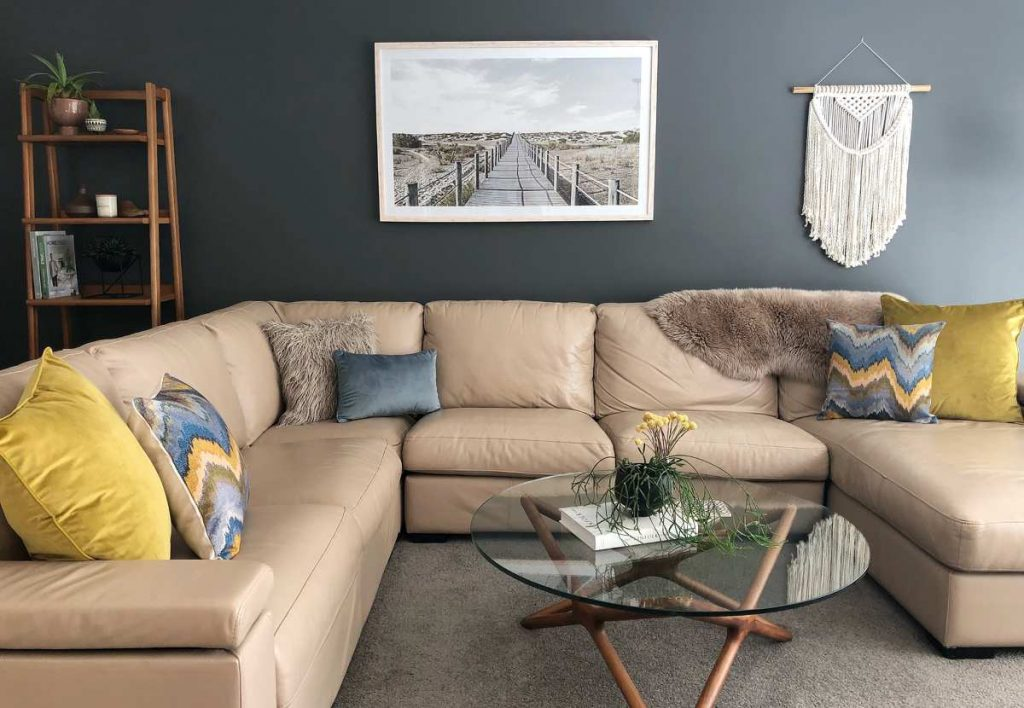Lounge room scene with beautiful mustard and blue cushions