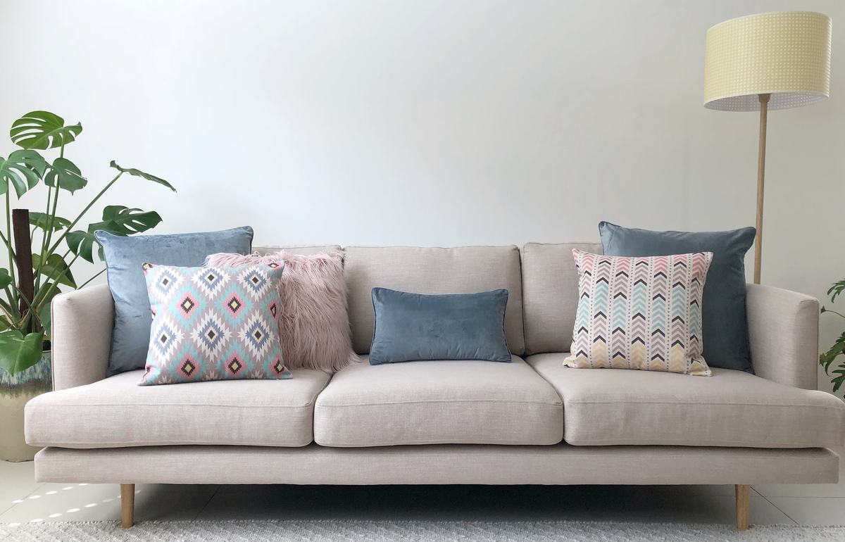 Neutral sofa with blue and grey pastel cushions
